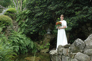 Bridal portrait of young woman in lush garden