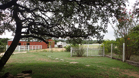 view of the property showing barn and pasture